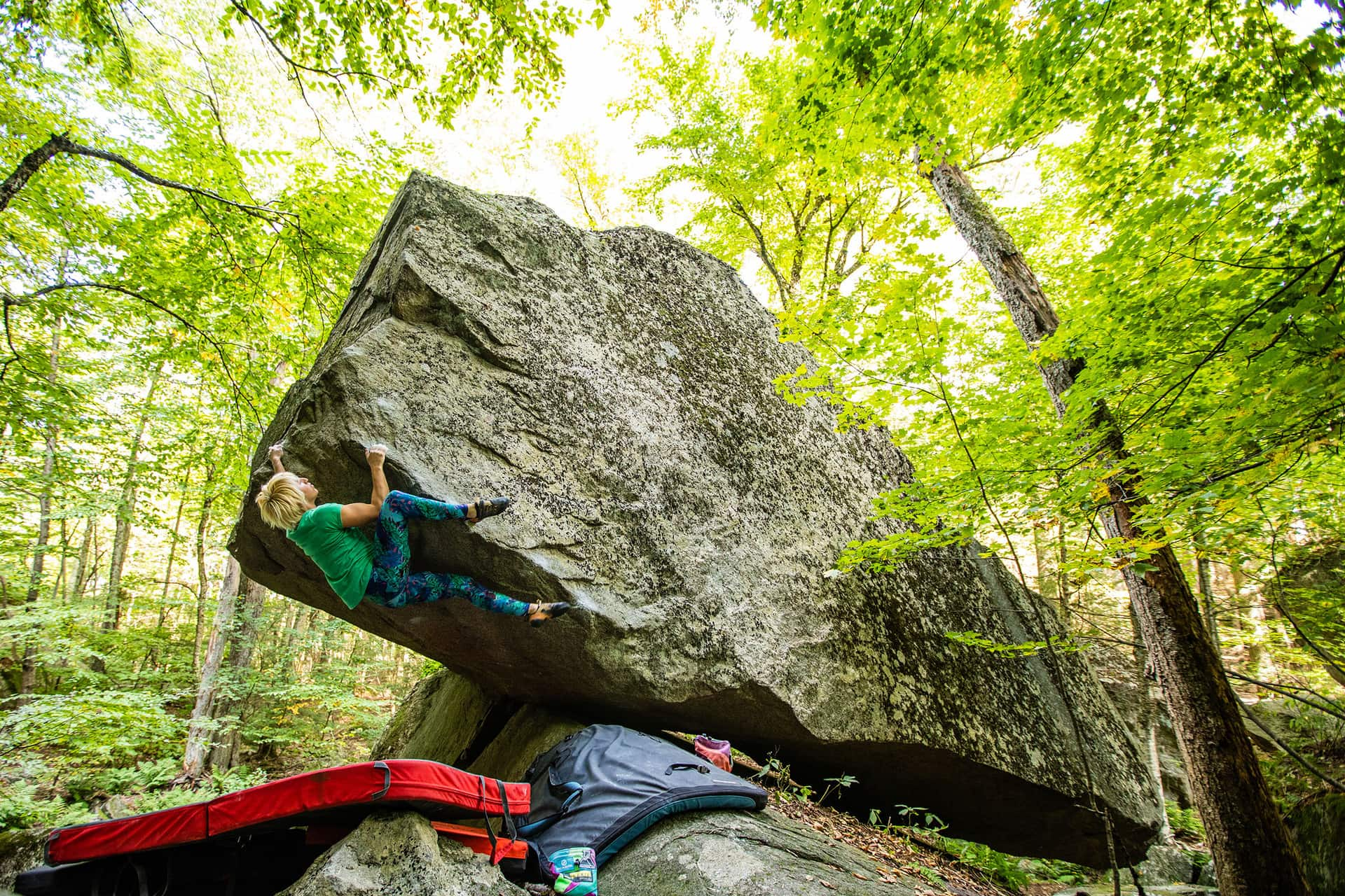 "Michaela Tracy on ""Numb Thumb"" (V7) at Pawtuckaway State Park."